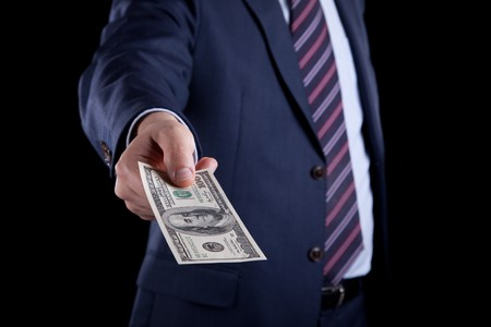 businessman giving money Stock Photo - 6954054