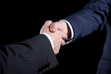 black handshake: handshake between two businessman after closing the contract