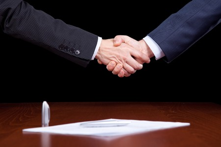 handshake between two businessman after closing the contract Stock Photo - 6954350