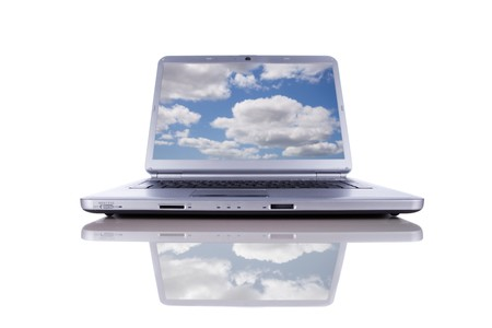 cloudshape: Cloud computing concept in a modern laptop isolated on white Stock Photo