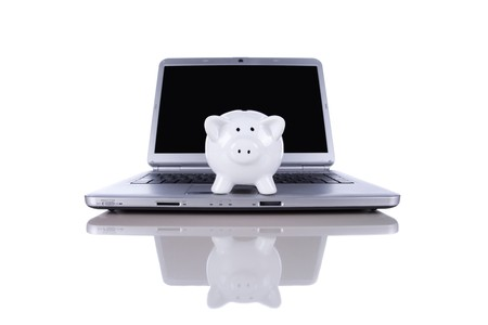 Piggybank over a modern laptop, the cost of technology and information (isolated on white) Stock Photo - 6953478