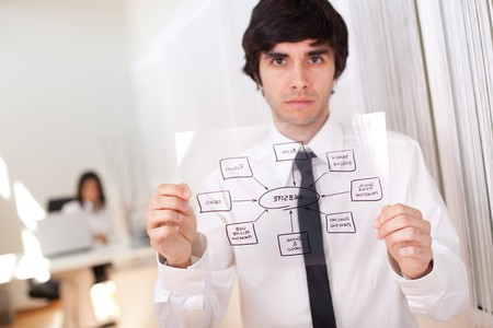 Businessman holding a website schema solution (selective focus with shallow DOF). photo