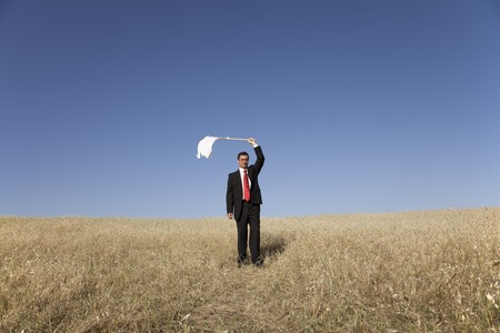 businessman asking for surrendering with a white flag Stock Photo - 6954408