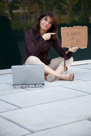 businesswoman looking for a job next to a office building photo