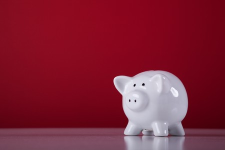 savings: piggy bank with a red background Stock Photo