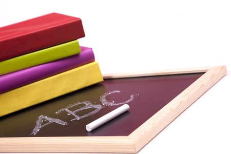ABC letters written on a blackboard with colorful books (selective focus) Stock Photo - 6954279