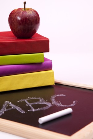 Back to school letters written on a blackboard with colorful books (selective focus) Stock Photo - 6954335