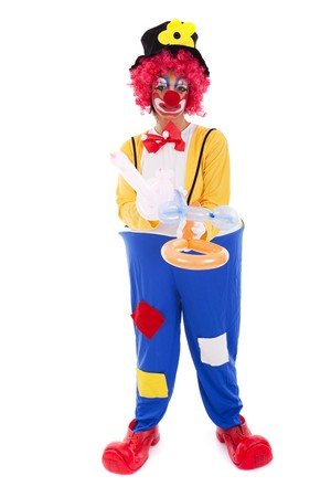 Funny clown standing over a white background photo