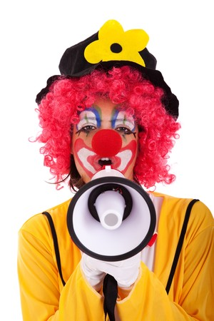 funny clown shouting at the megaphone (isolated on white) photo