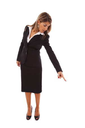 bend over: businesswoman pointing down (isolated on white)