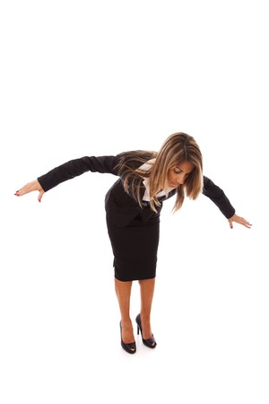 businesswoman loosing her balance (isolated on white) photo
