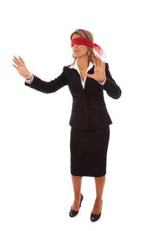 blindfold businesswoman trying to find something (isolated on white) photo
