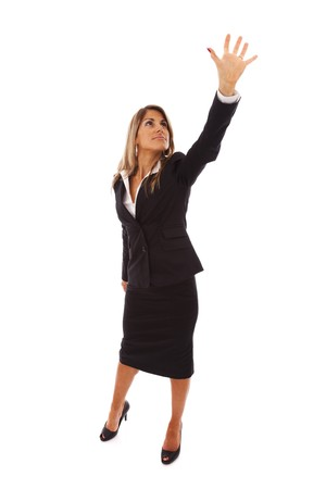 grabbing: businesswoman trying to reach something with her hand Stock Photo