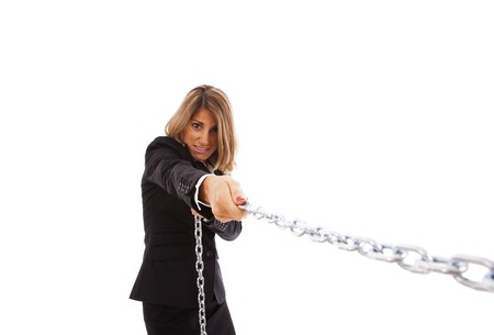 businesswoman pushing a chain (isolated on white) photo