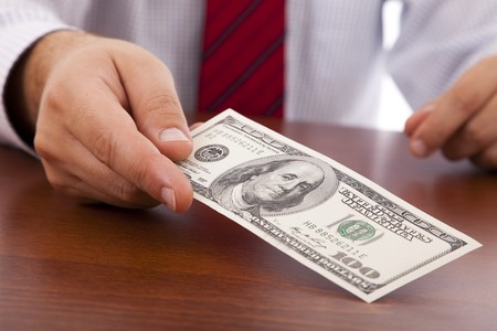 businessman at the office giving money Stock Photo - 6954370