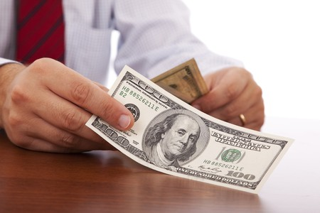 businessman at the office giving money Stock Photo - 6954378