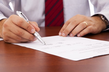subscribing: businessman at the office signing a contract Stock Photo