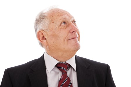 Senior businessman smiling and looking to the copyspace (isolated on white) Stock Photo - 6954330