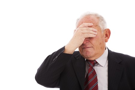 worried executive: senior businessman hiding is face (isolated on white) Stock Photo
