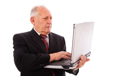 senior businessman working with a laptop (isolated on white) Stock Photo - 6954313
