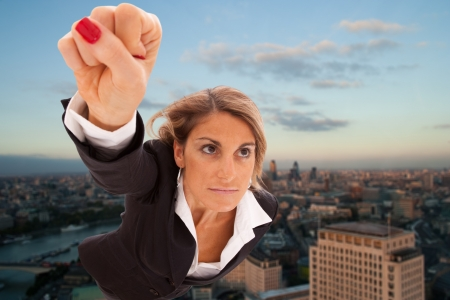 Super businesswoman flying over London city Stock Photo - 6953432