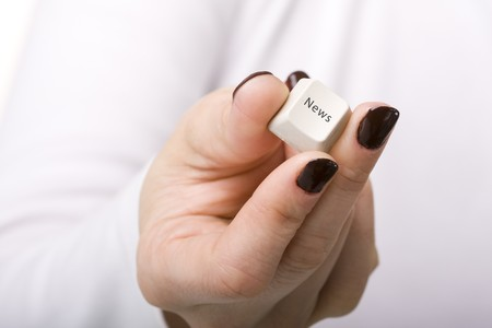 woman hand holding the News key from the keyboard photo