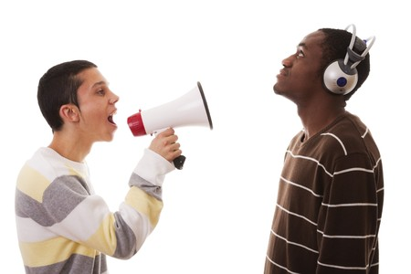 multi race: caucasian young man shouting to a african young man Stock Photo