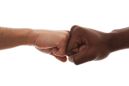 multiracial fist to fist agreement (isolated on white) photo
