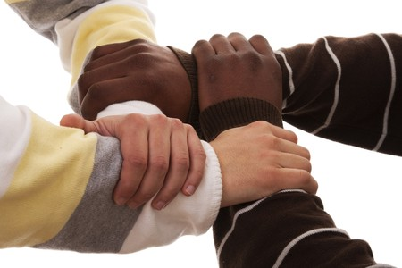 joined hand of a multiracial team (isolated on white) Stock Photo - 6953902