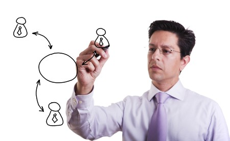 businessman drawing a social network scheme on a whiteboard (selective focus) Stock Photo - 6953434