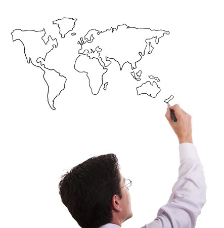 map pencil: businessman drawing the world map in a whiteboard (selective focus)