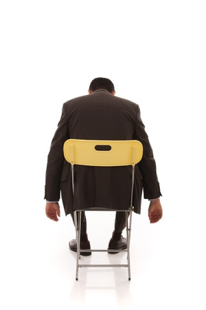 overwrought: businessman sleeping in a yellow chair (isolated on white) Stock Photo