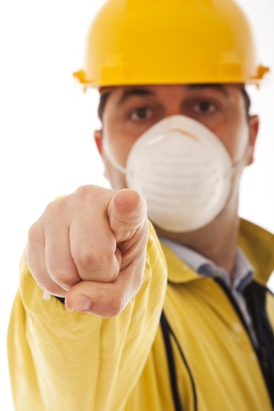 engineer with protective uniform pointing to you (selective focus) photo