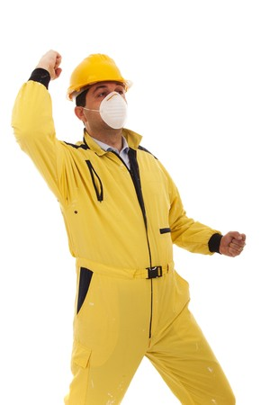 engineer with protective uniform showing something and looking to the copy space photo