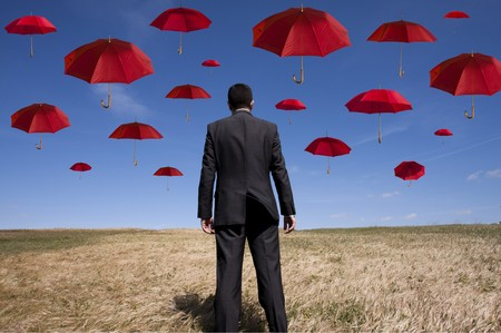 businessman find the best insurance solution out there (umbrella out of focus) Stock Photo - 6954274