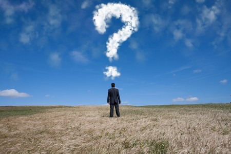 businessman standing alone at the field with a lot of questions in his mind Stock Photo - 6954048