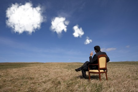 businessman sitting in a chair thinking about the future the field Stock Photo - 6954171
