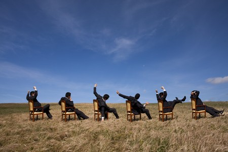 Six businessman relaxing at the field photo