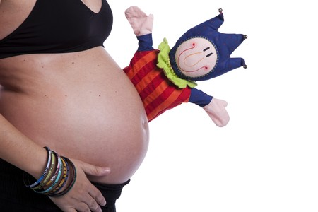 Funny puppet showing an happy pregnant woman (isolated on white) photo