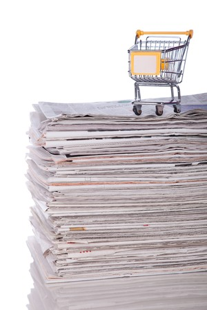 Shopping cart to buy the latest news (selective focus) Stock Photo - 7812188