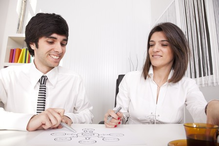 businesspeople working on EMail Marketing schema (selective focus) photo