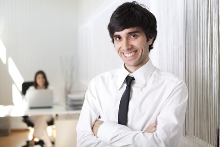 Modern and successful businessman at his office photo