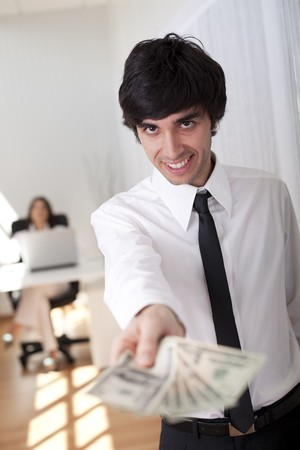 businessman at the office giving you money photo