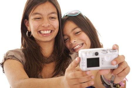 two young sisters making a photo of them self (selective focus) photo