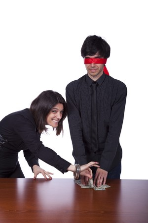businesswoman partner sealing from a blindfold businessman (isolated on white) photo