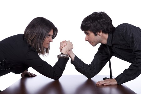 Men and woman in a arm wrestling at the office photo