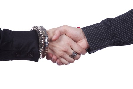 handshake from a men and a woman (isolated on white) Stock Photo - 7810635