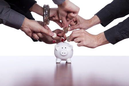 white fund: Many hands saving money in the piggy bank