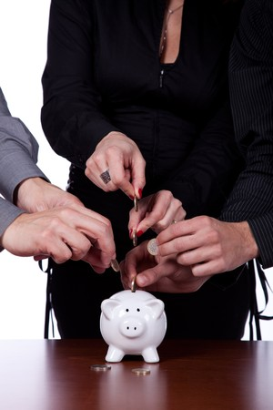 Many hands saving money in the piggy bank photo