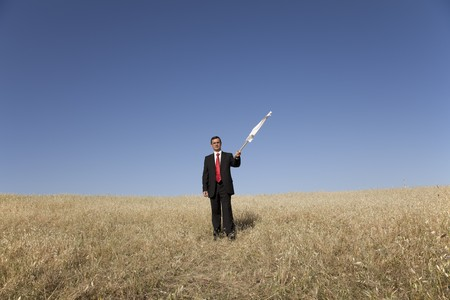 businessman asking for surrendering with a white flag Stock Photo - 7812241